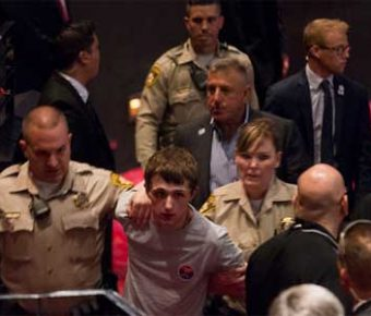 Michael Sandford tries to disarm cop at trump rally