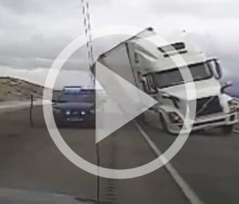 A semi crushed a Wyoming Highway Patrol car in this video.