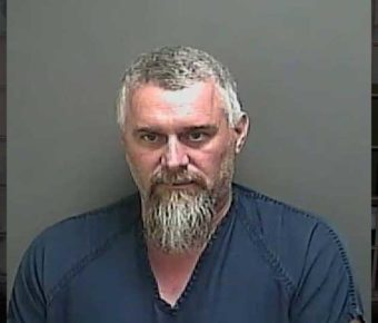 Christopher Sutton was arrested after telling people to booby-trap their yards in order to hurt officers.