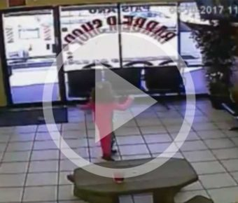 Surveillance video shows bullets flying by a 4-year-old girl in a Chandler barber shop.