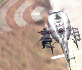 LAPD used a SWAT sniper from a helicopter to take out a suspect who was firing at police.