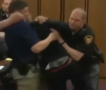 Video shows victim's brother attack the killer in court.