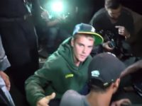 Justin Bieber ran over a photographer who was standing in front of his truck.