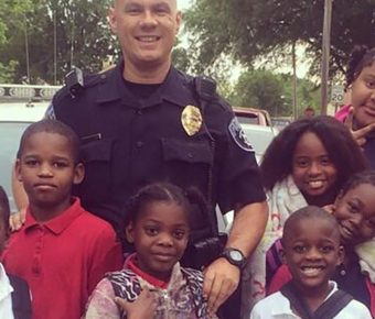 Officer Tommy Norman has become friends with the children in the community.